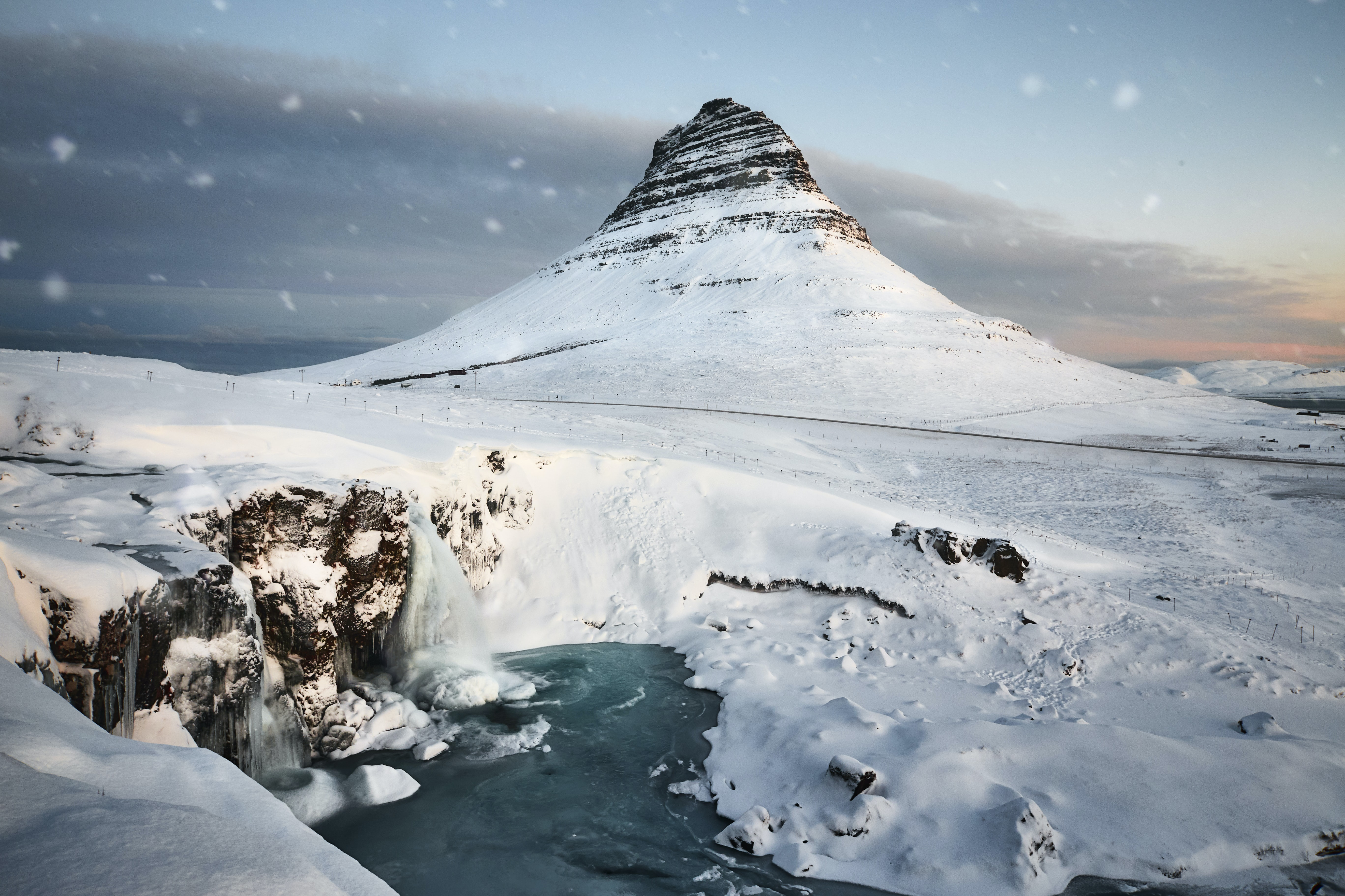 kirkjufellfoss in Iceland covered with snow during daytime