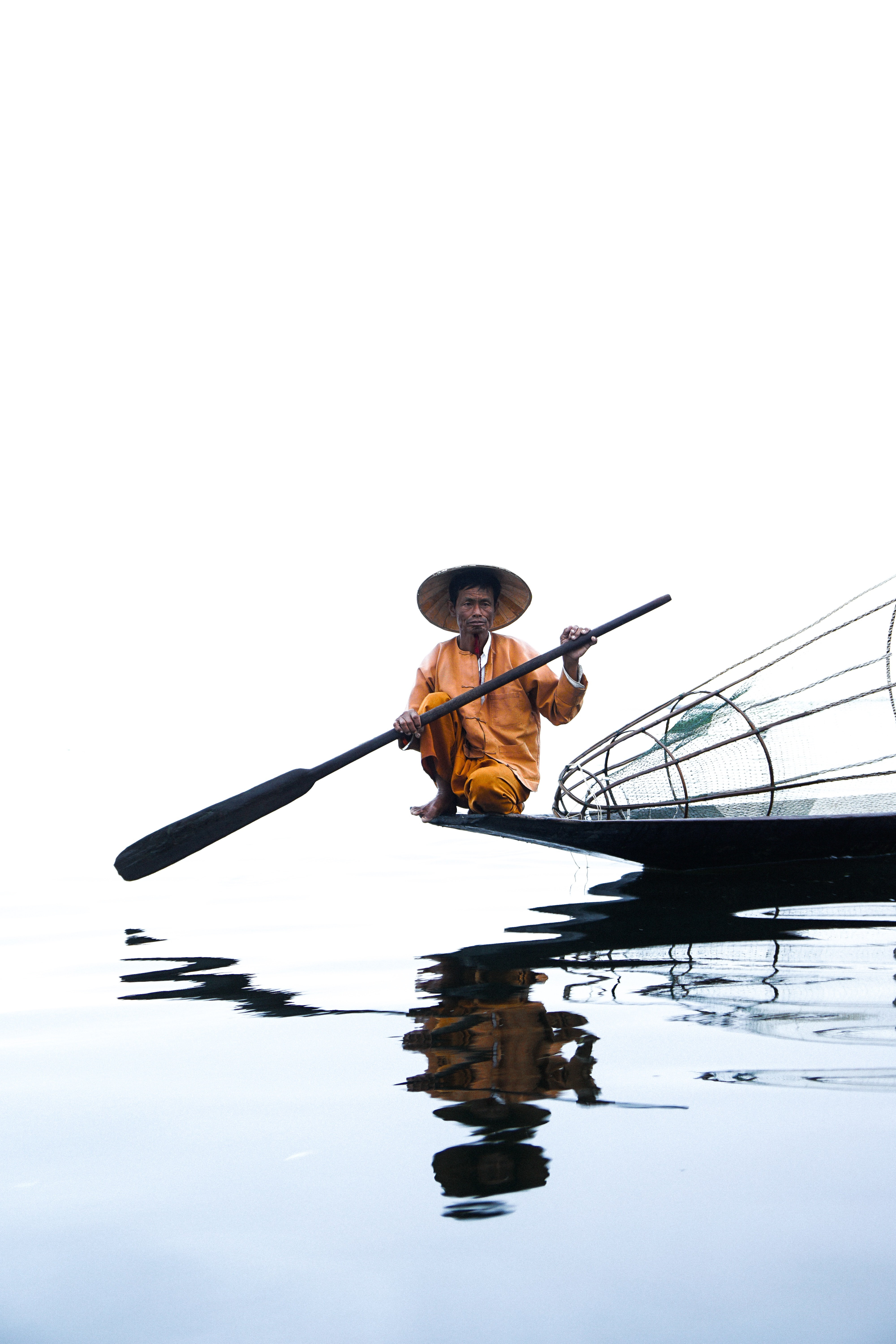 man on boat holding paddle