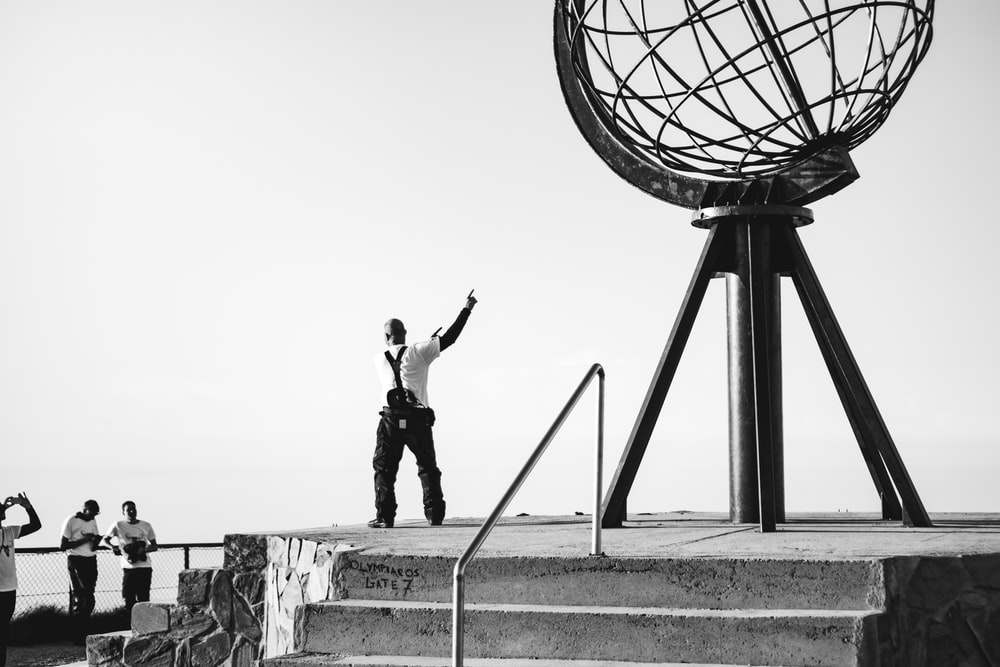man standing near metal structure
