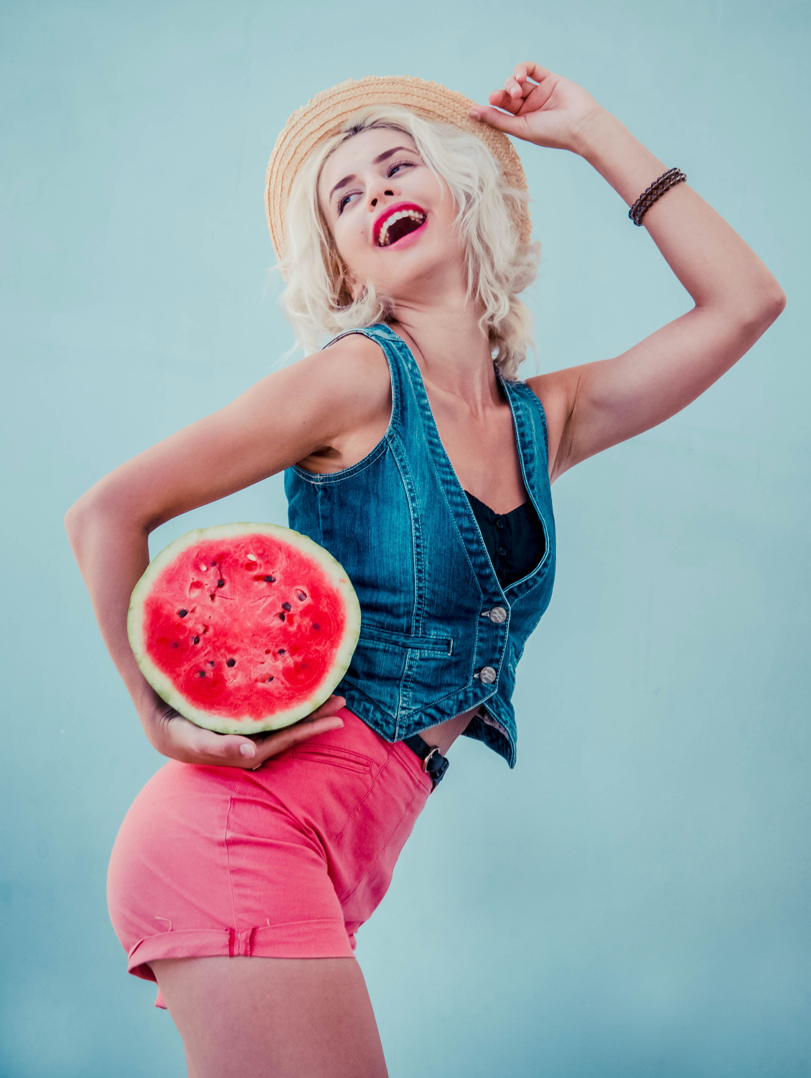 woman carrying watermelon
