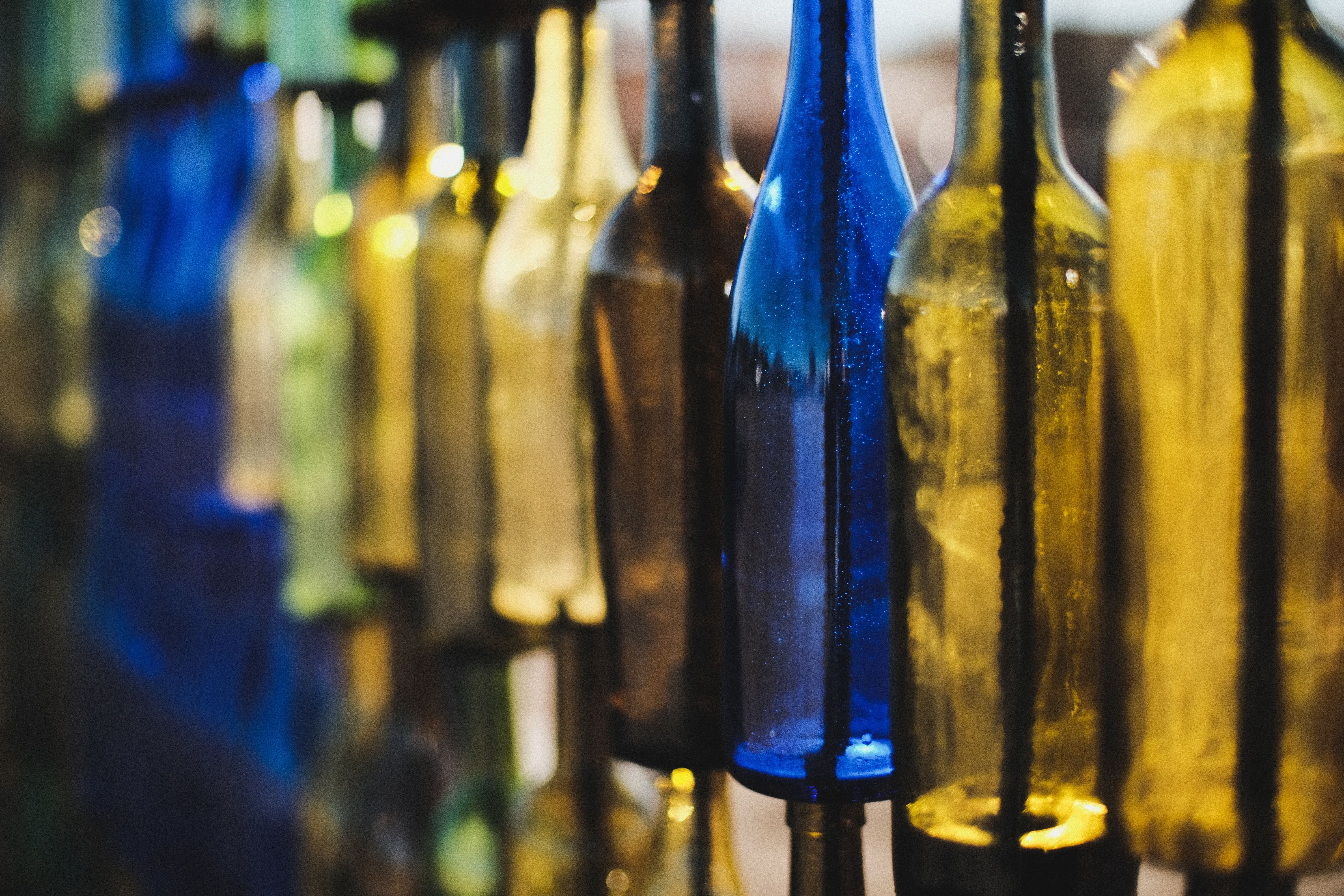selective focus photography of glass bottles