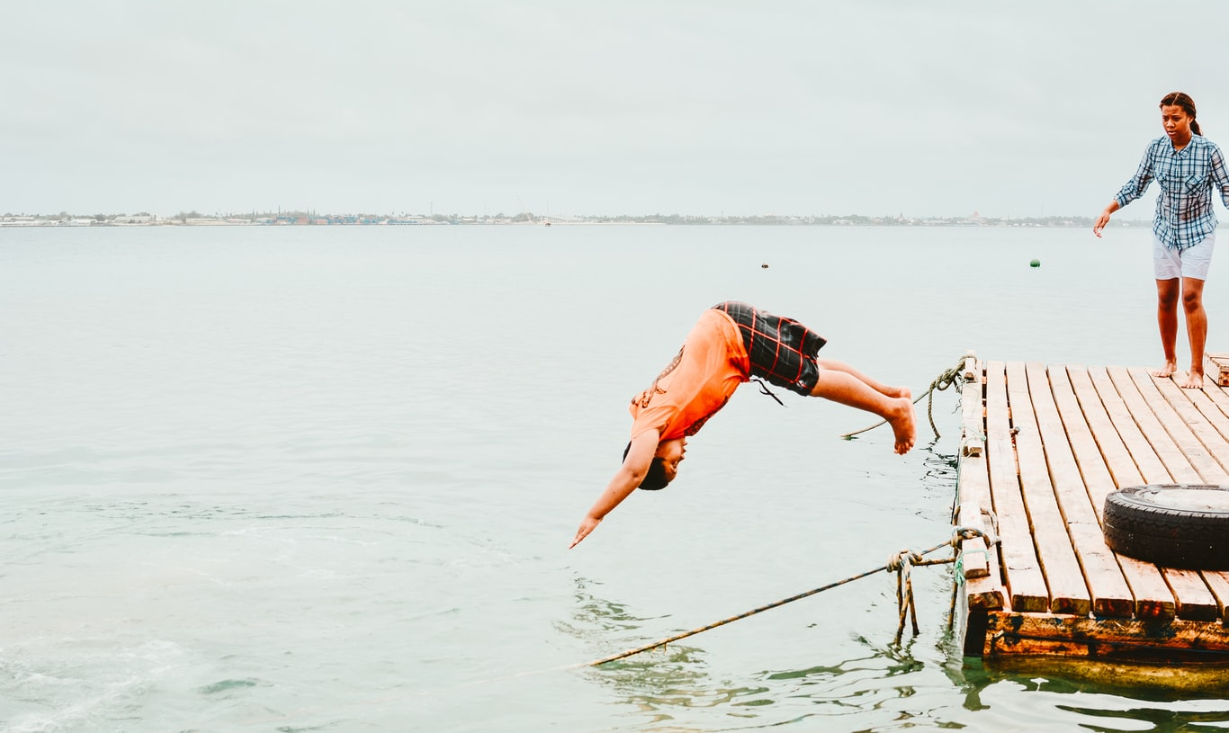 woman diving on water