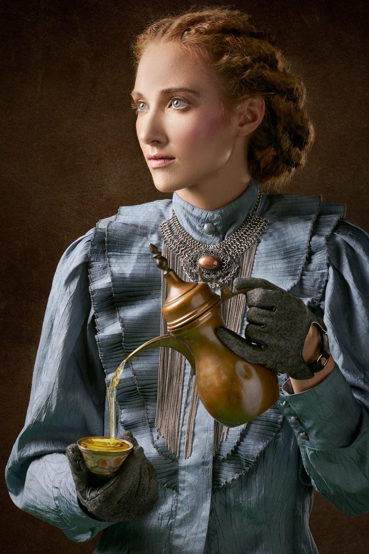 woman holding turkich teapot