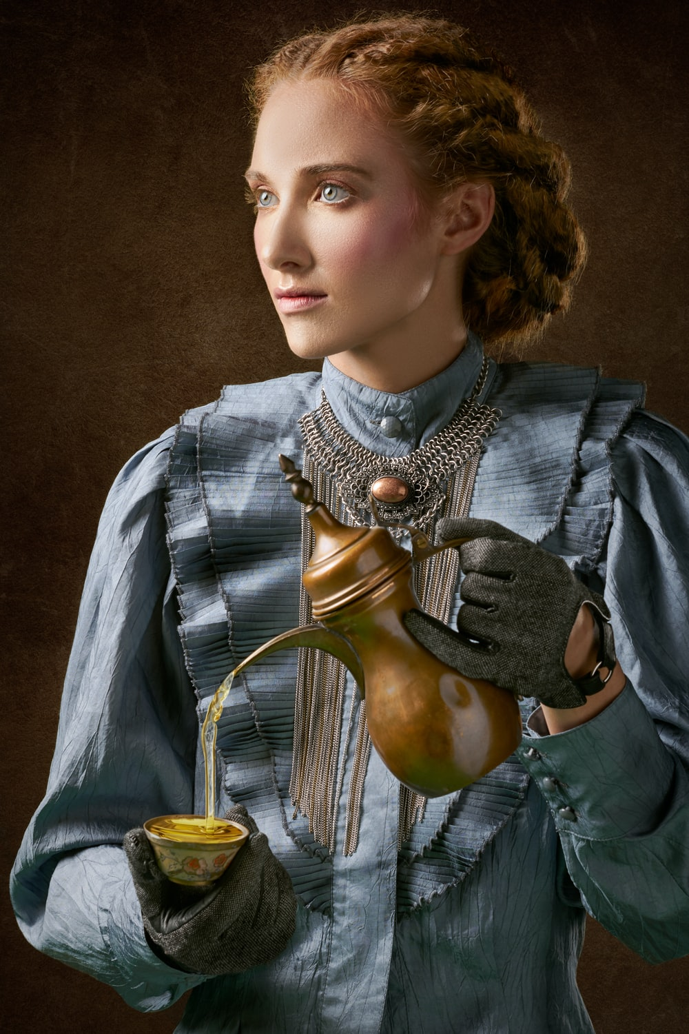 woman holding turkich teapot