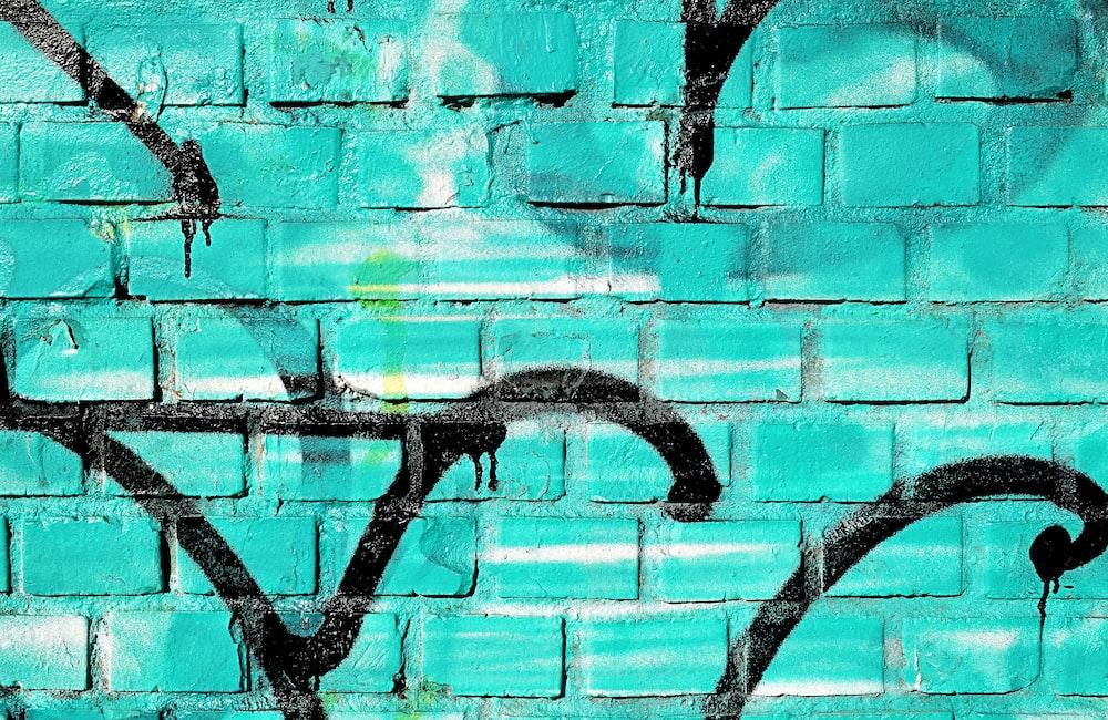 teal and black graffiti wall
