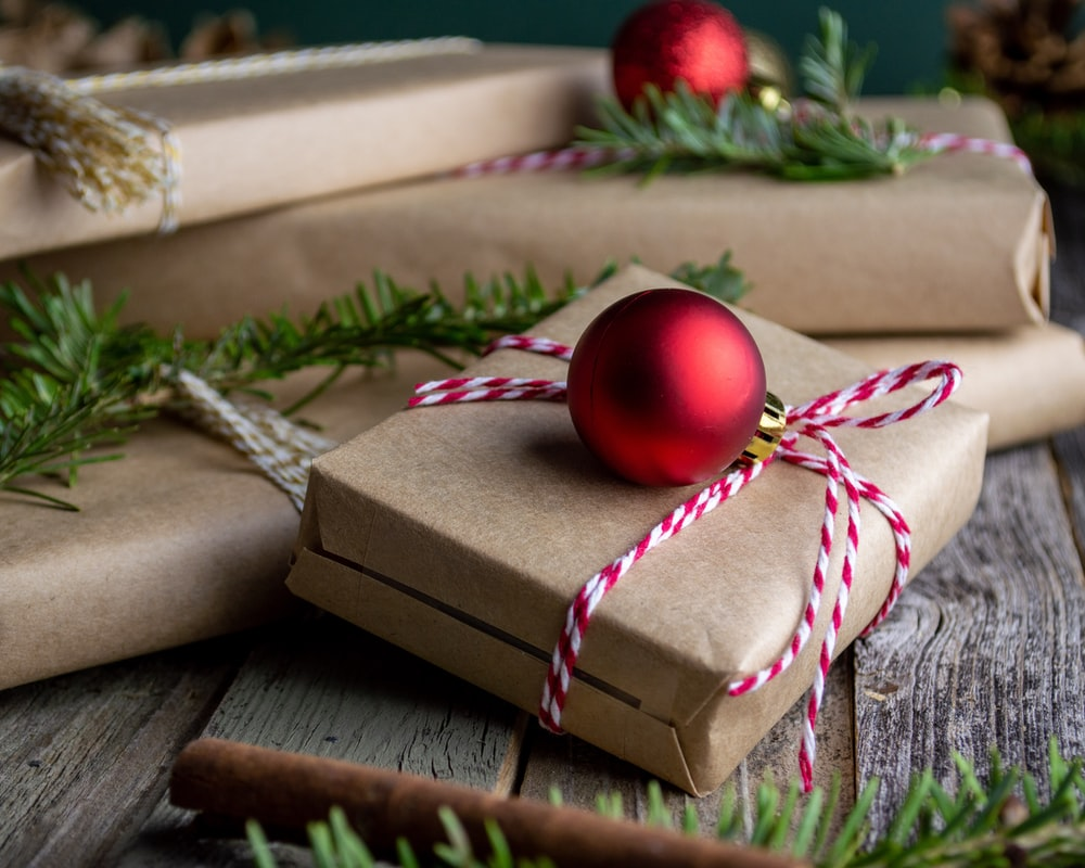 red bauble on brown giftbox