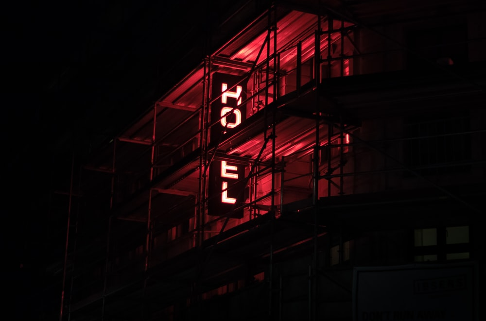 red-lighted hotel signage
