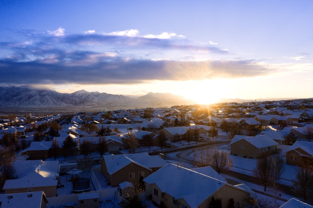 houses covered with snow during golden hour