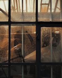 black metal framed glass panel window