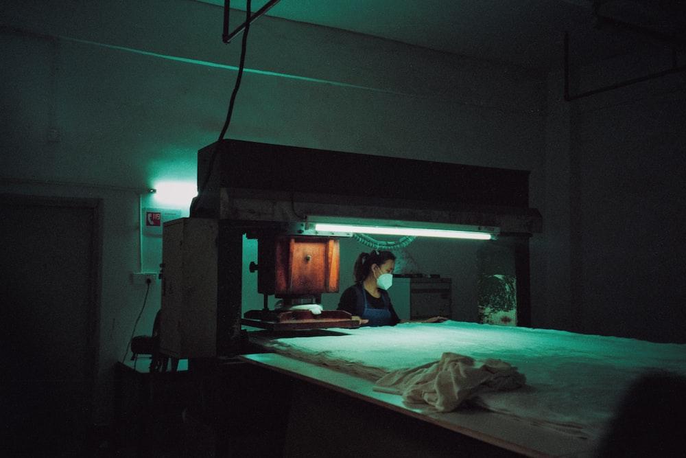 woman wearing face mask near industrial machine