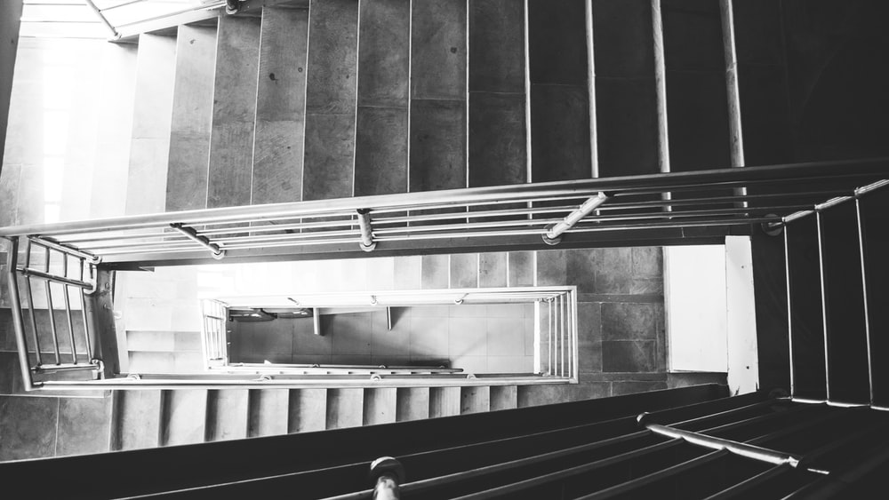 grayscale photography of empty staircase
