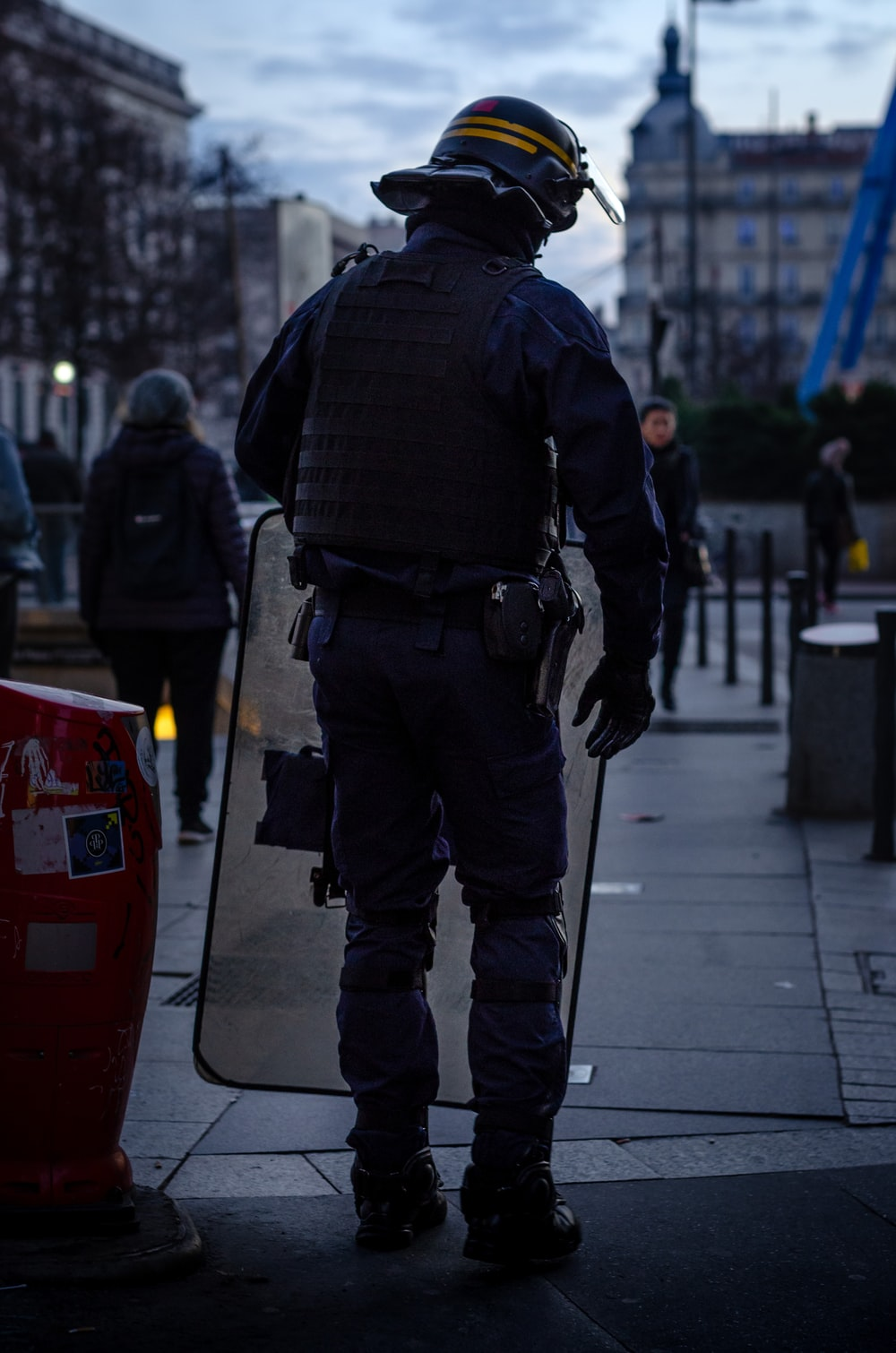police officer standing and carrying riot shield
