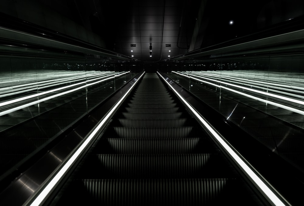 black escalator in close-up photography
