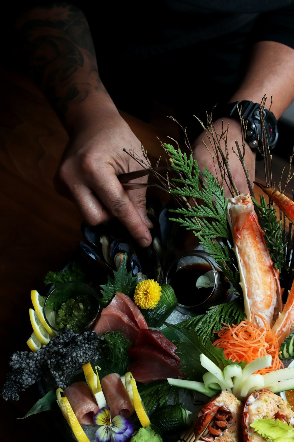 person fixing vegetables with flowers