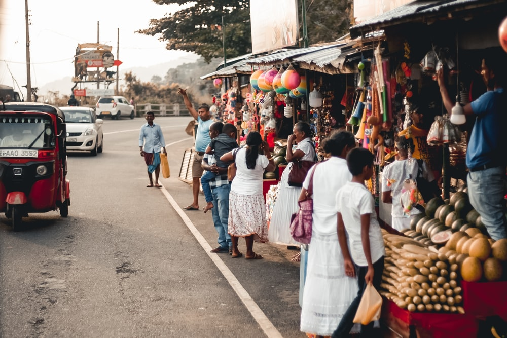 people buying from market
