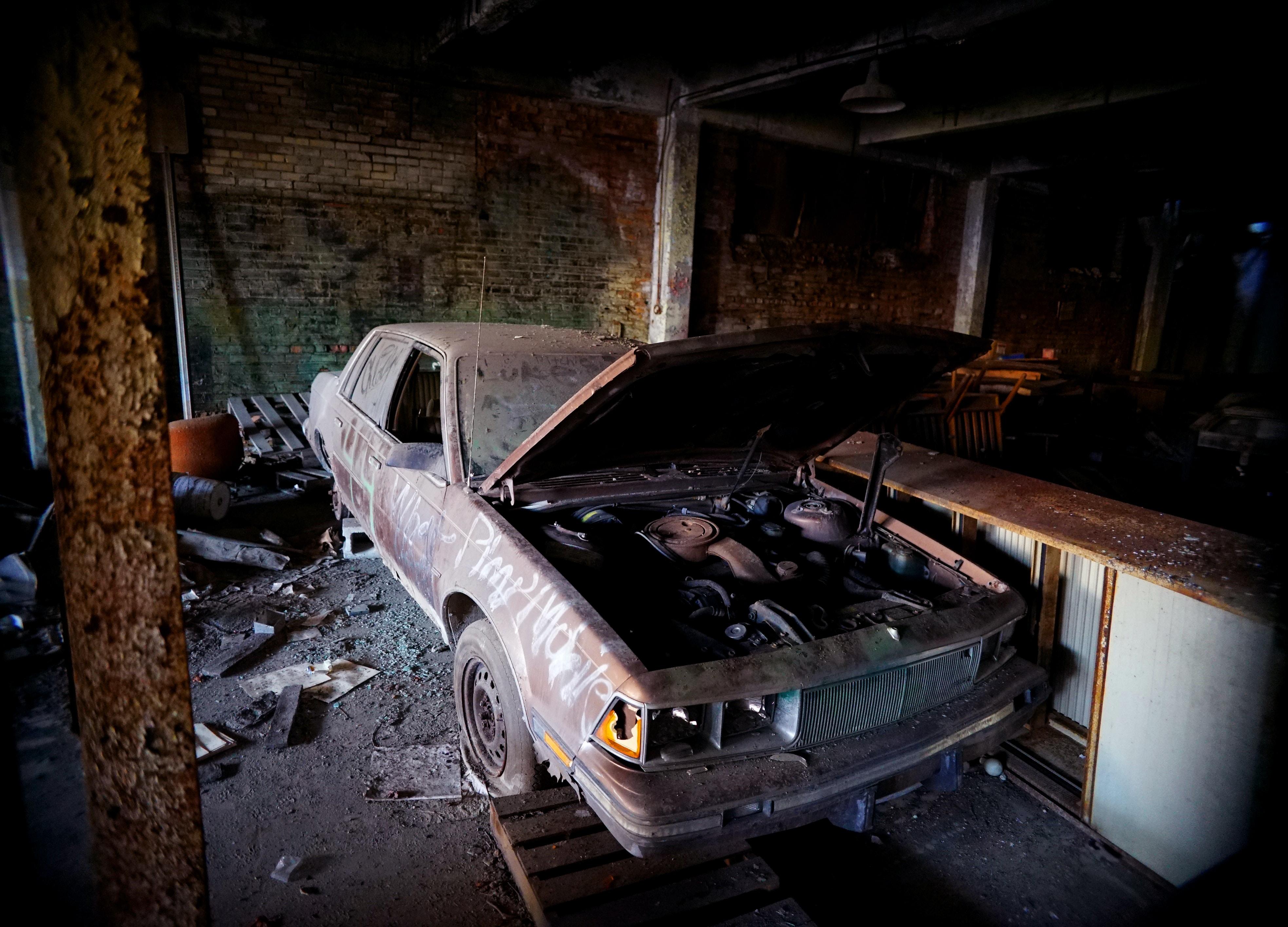 wrecked black car