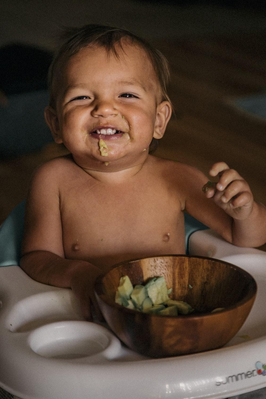 man eating vegetable in bowl