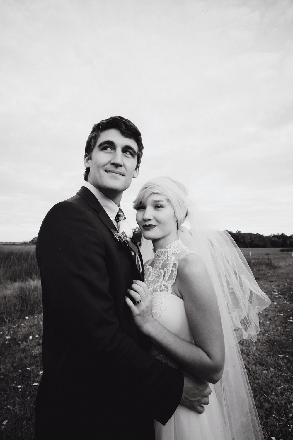 grayscale photo of bride and groom