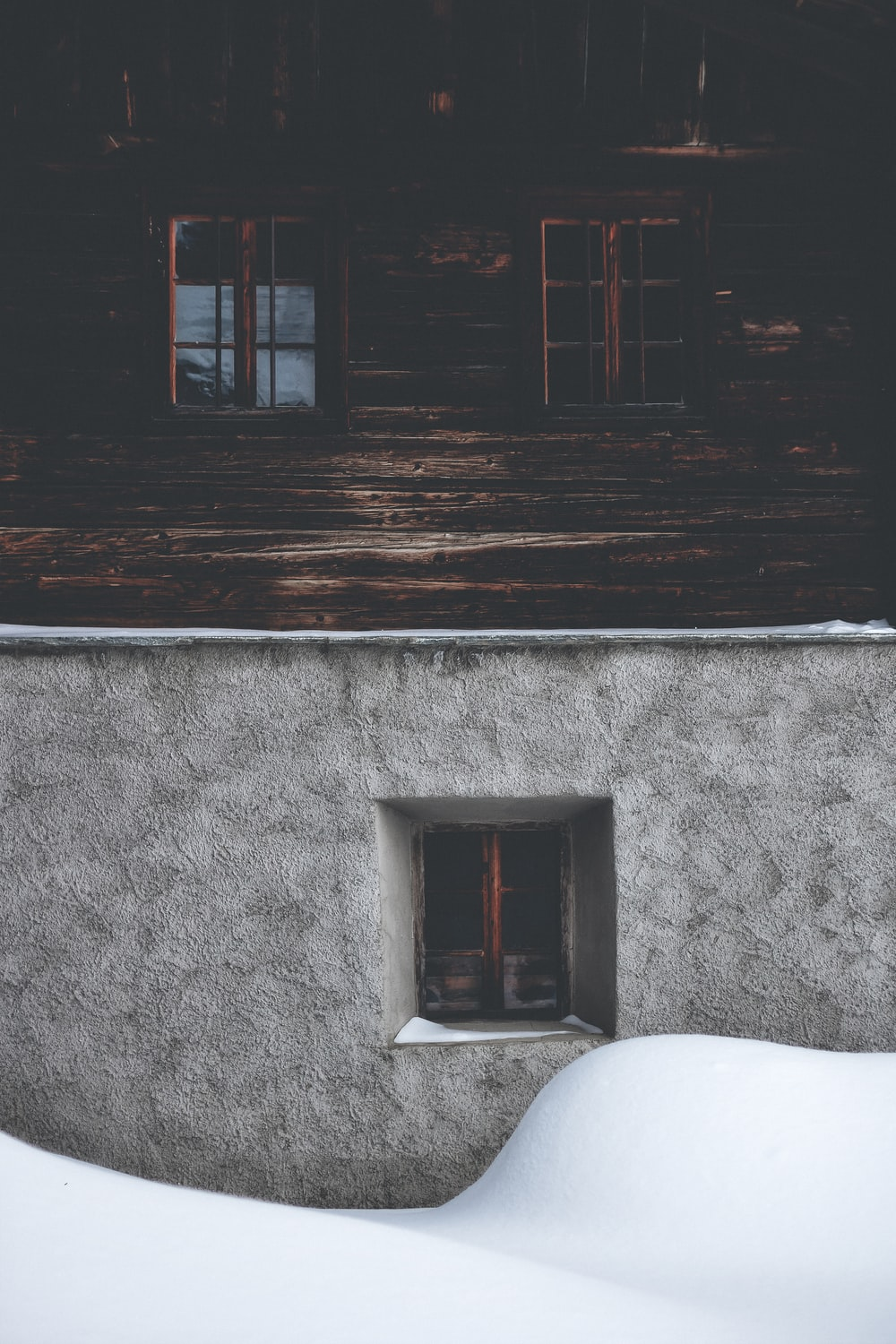 brown wooden building window and grey concrete building window