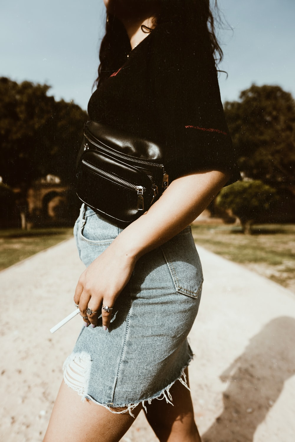 woman carrying brown leather crossbody bag
