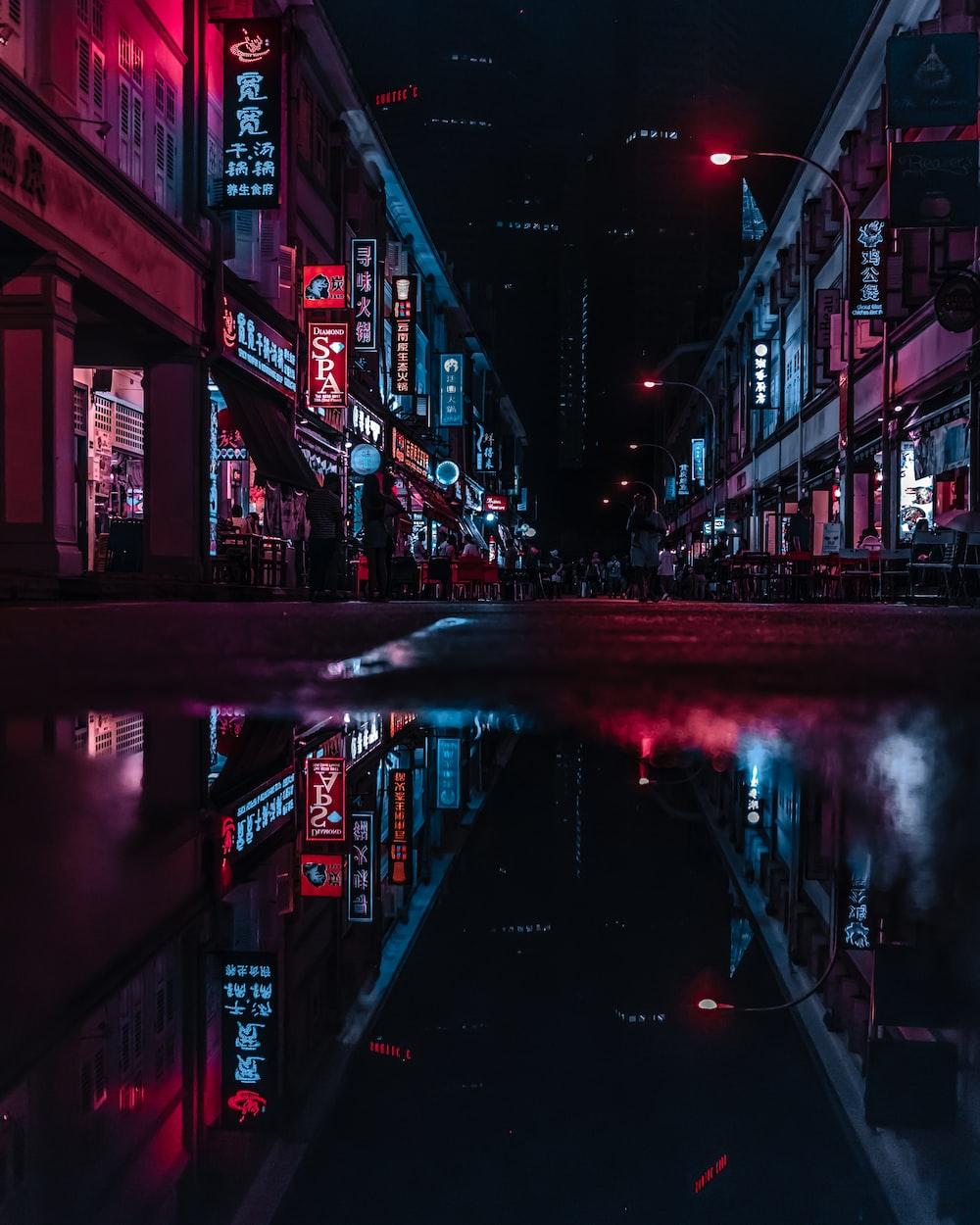 wet street in between building at night