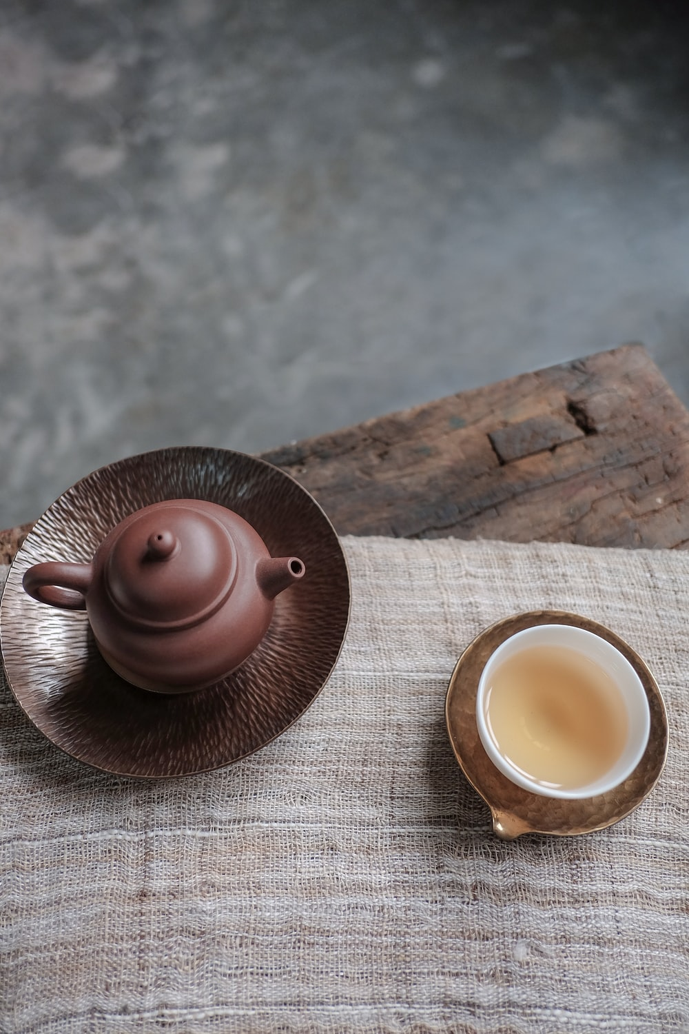 brown kettle and white cup on table