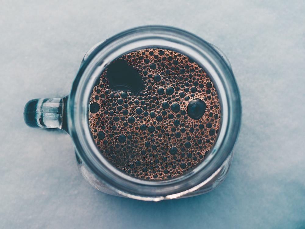 coffee in clear glass mug