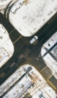 aerial photography of white car on crossing