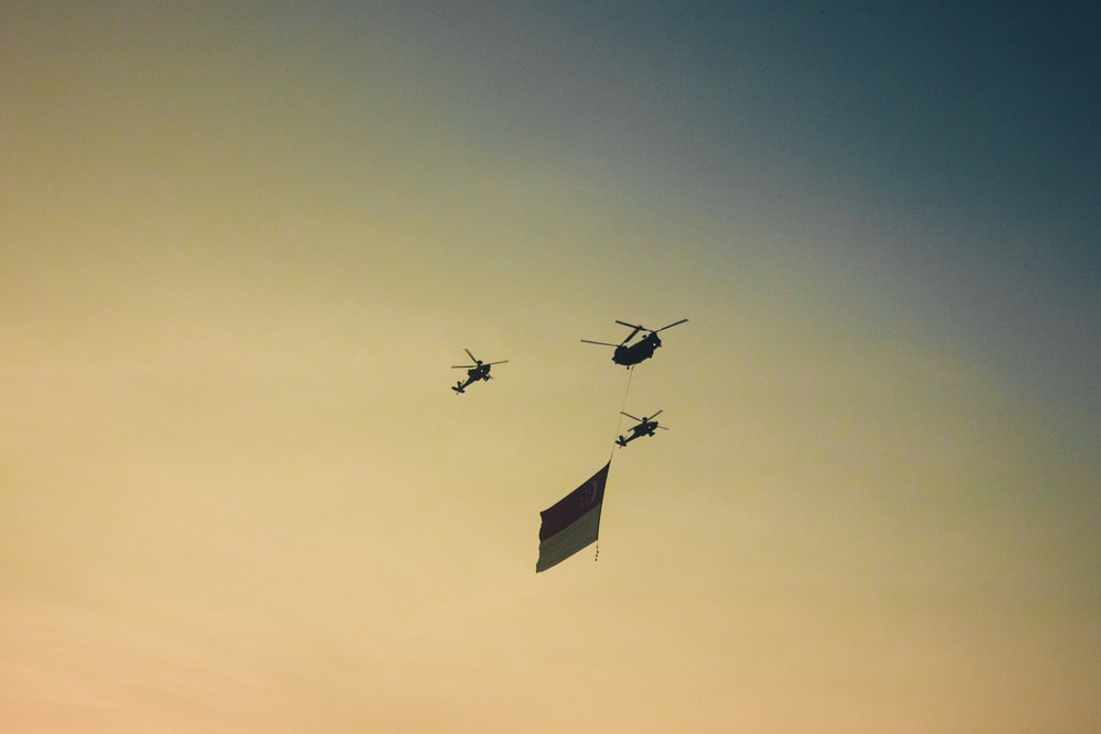 three black helicopters at midair