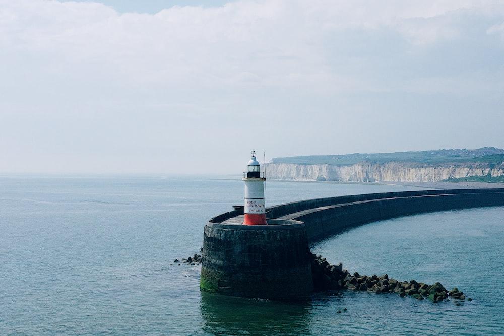 lighthouse near ocean during daytime