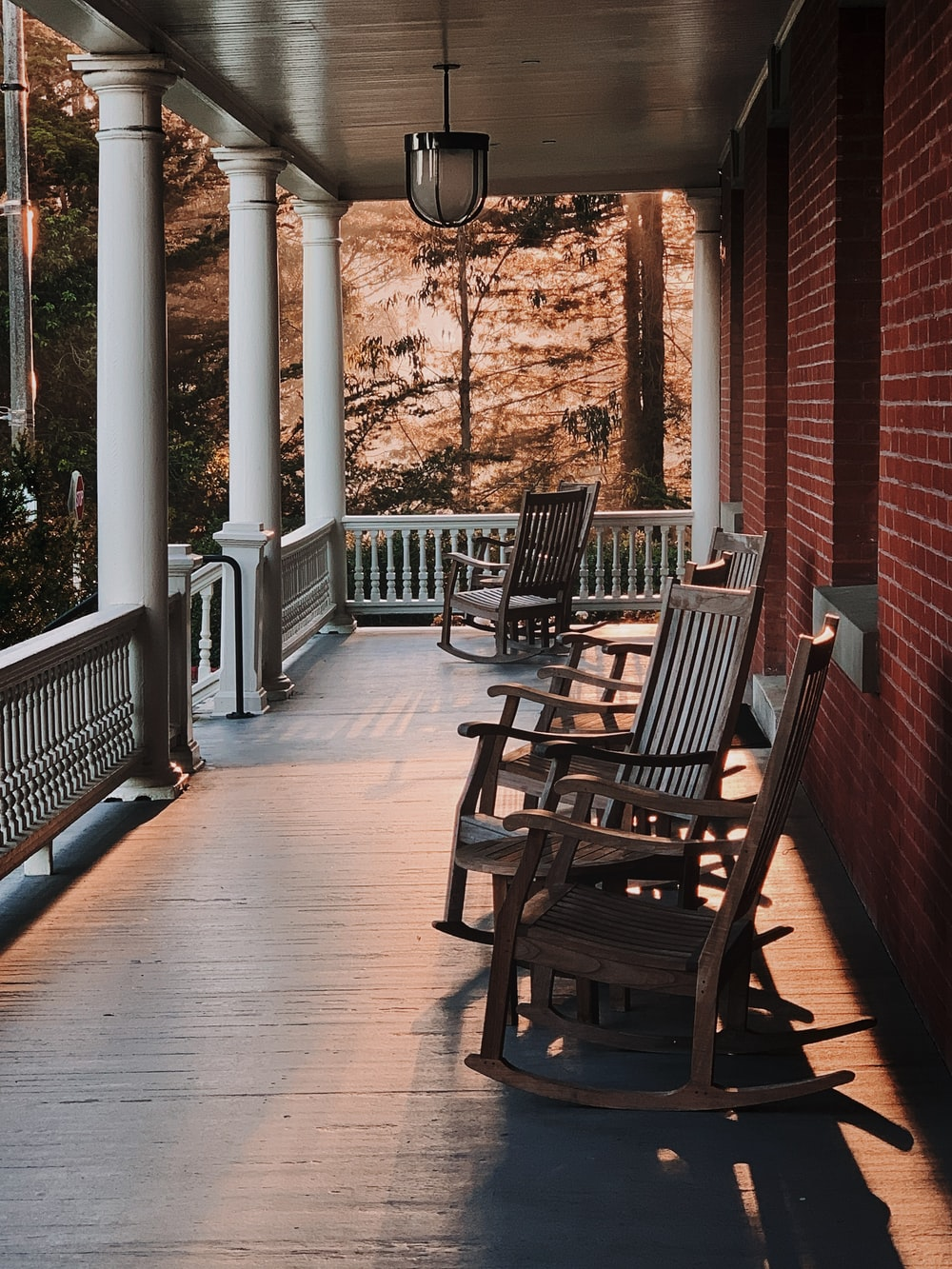 empty rocking chairs by porch