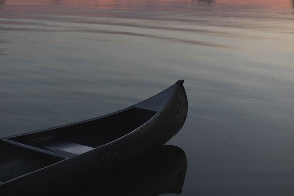 empty canoe boat on calm water