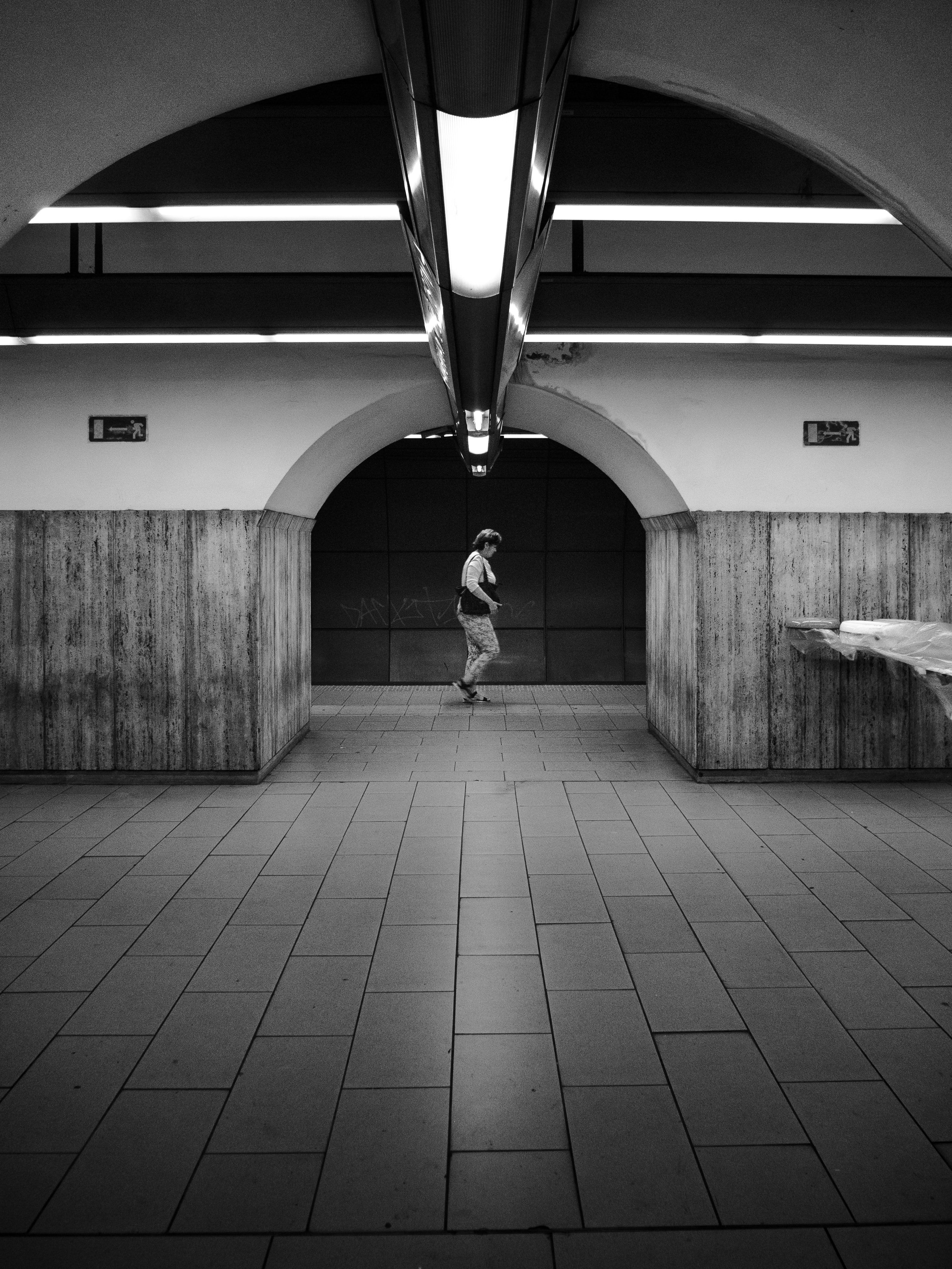 grayscale photography of man inside building