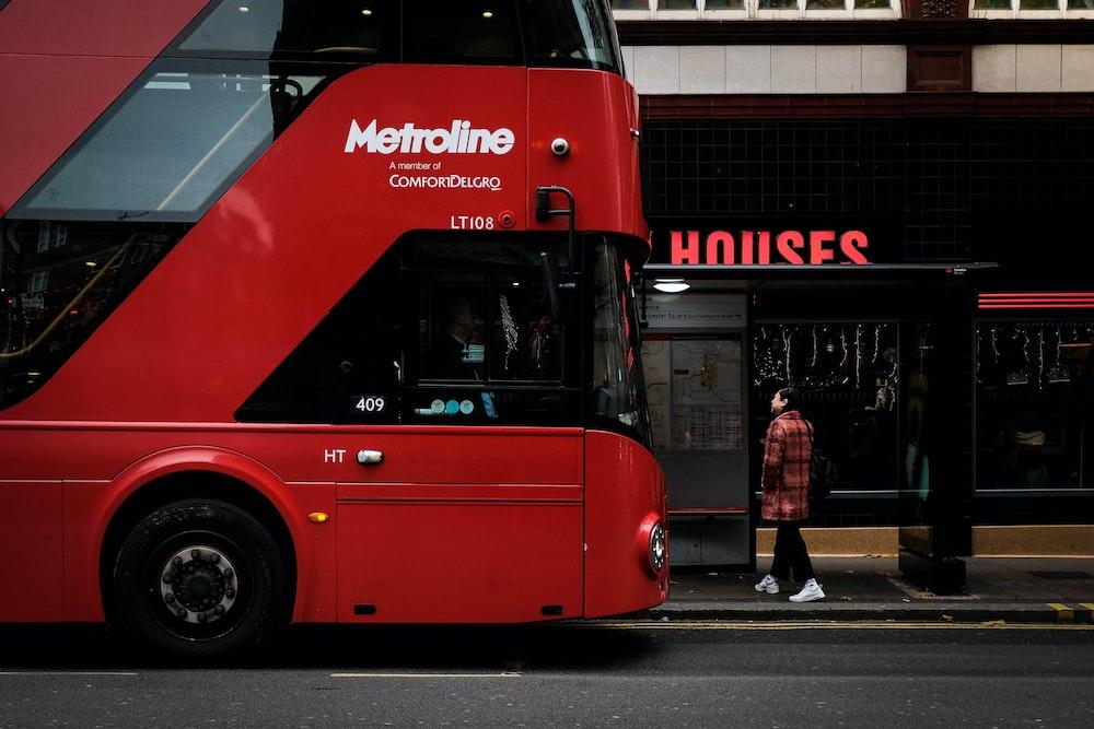 red Metroline double decker bus on road