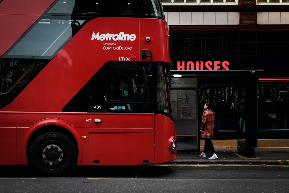 red Metroline double decker bus on road