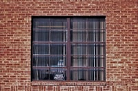 closed window on bricked building
