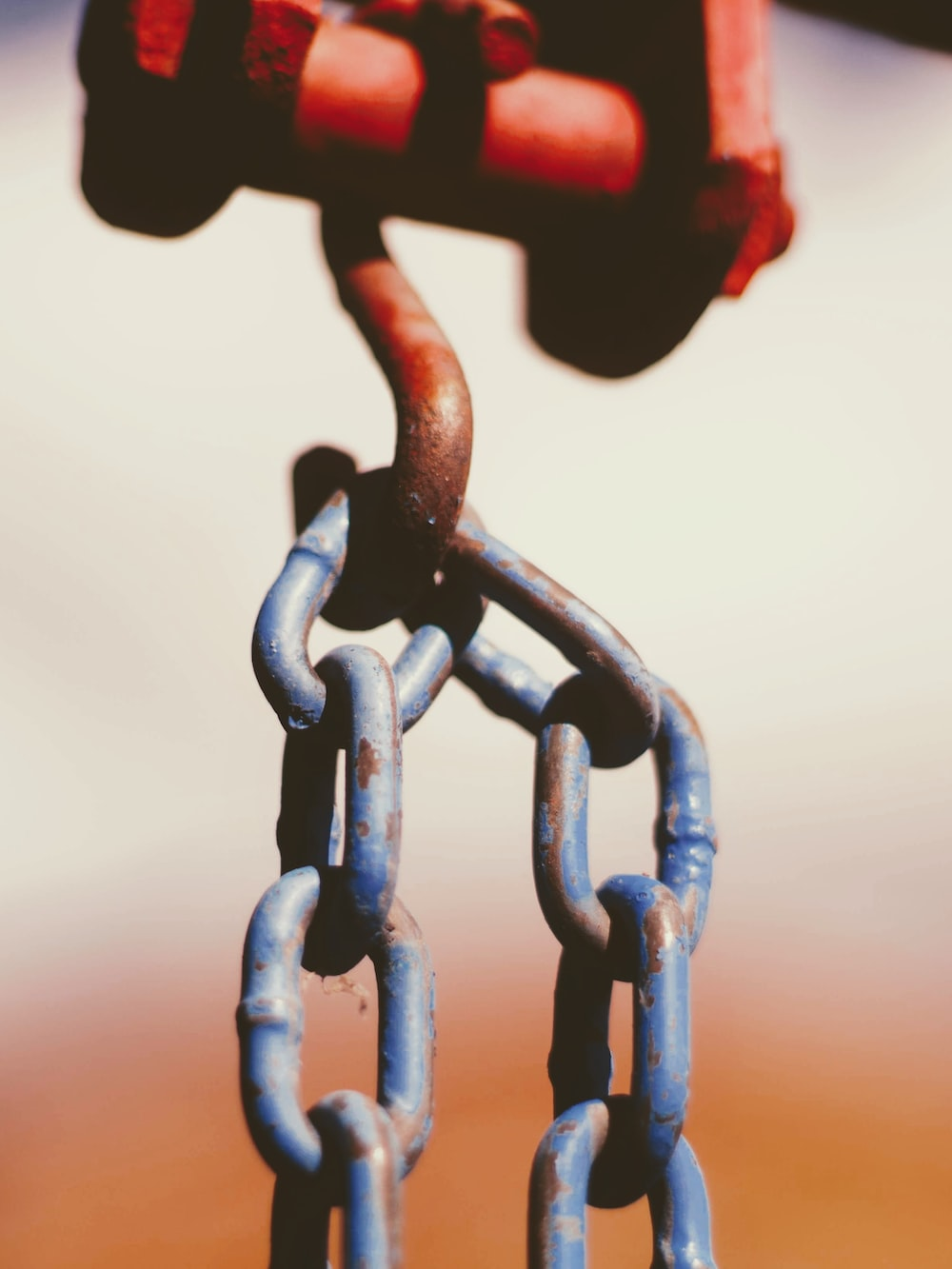 blue and orange metal chain link