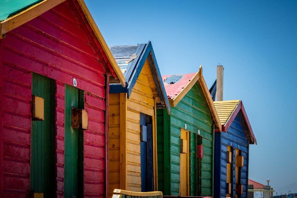 four assorted-color wooden houses