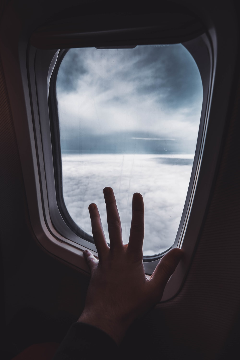 person holding airplane window