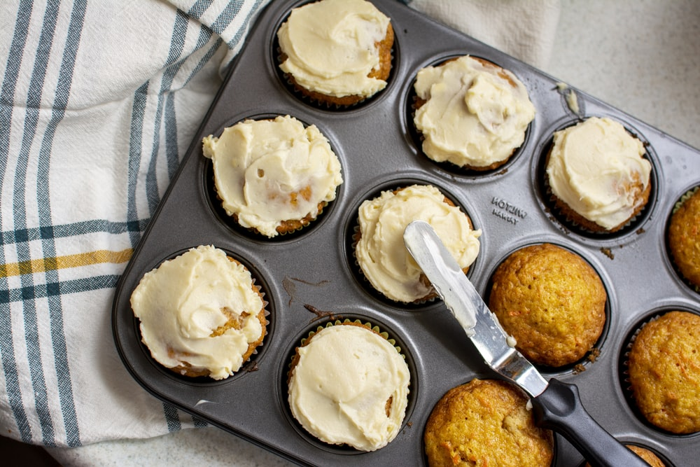baked pastry with cream on gray molder
