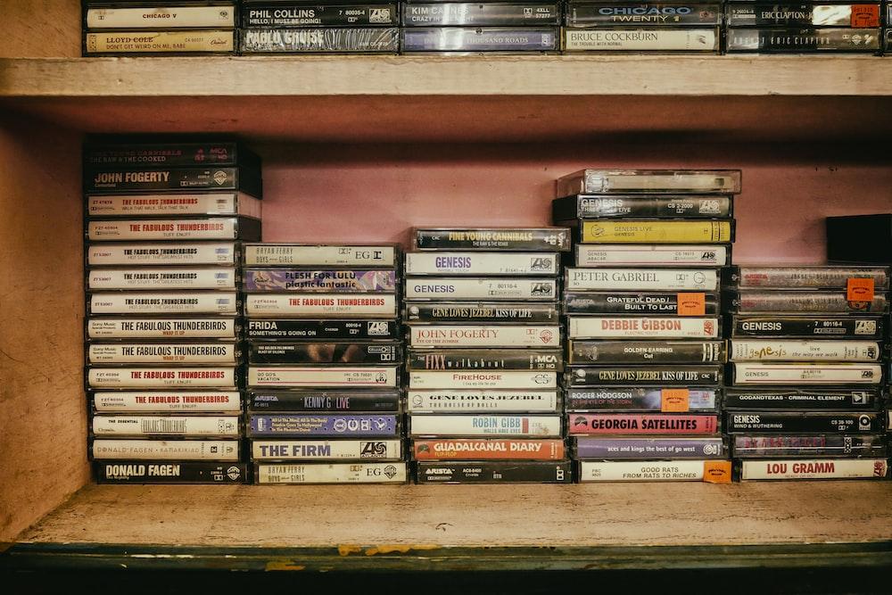 assorted cassette case lot on shelves