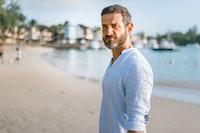 Man in a white linen shirt on the beach