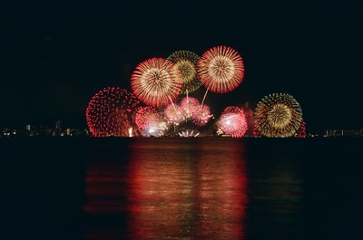 mirror photography of fireworks display fireworks teams background