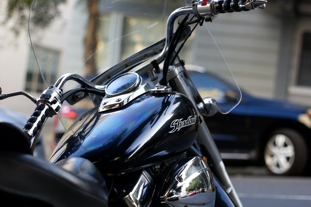 selective focus photography of cruiser motorcycle