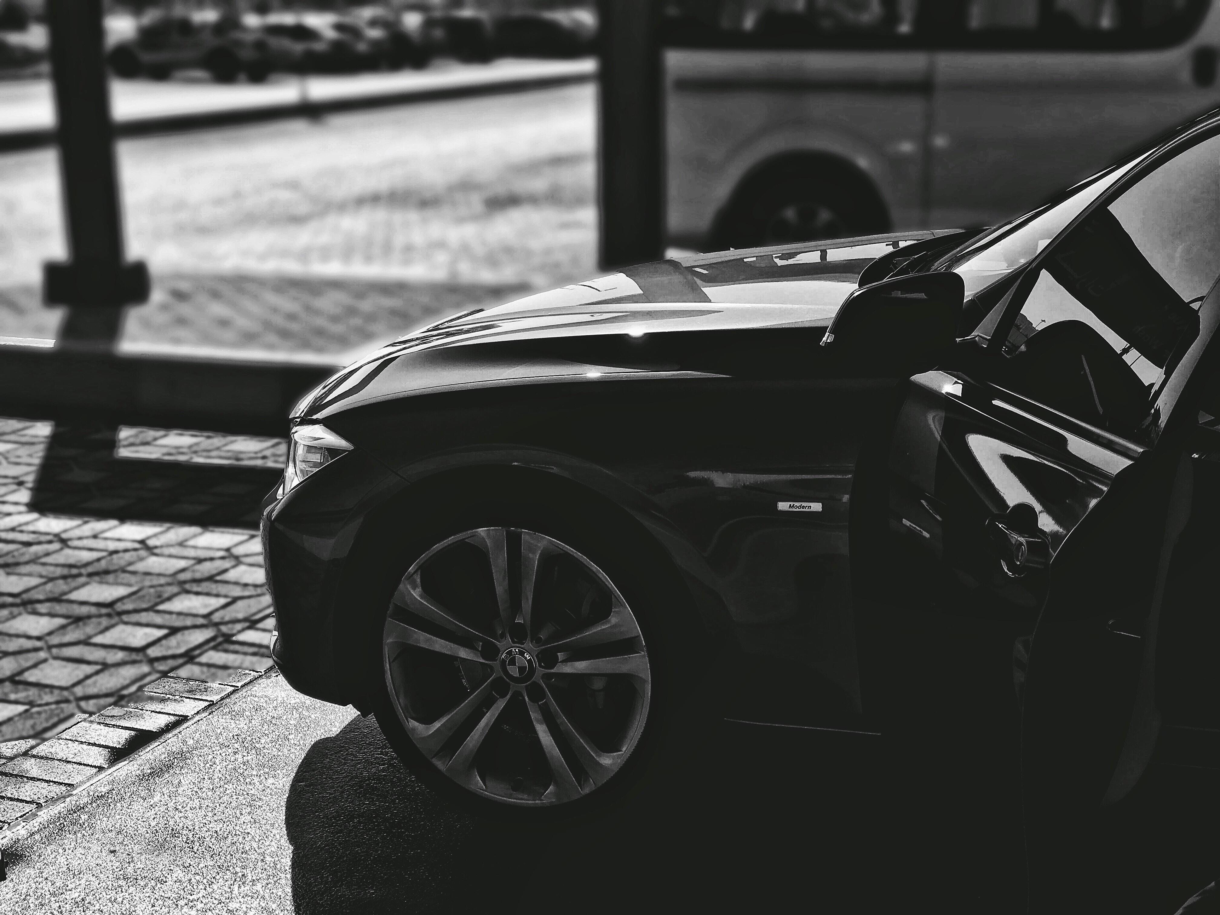 grayscale photography of vehicle hood