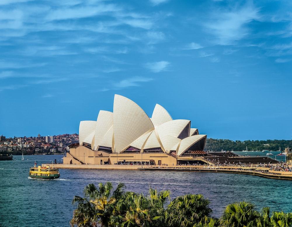 yellow boat near Sydney Opera, Australia during daytime