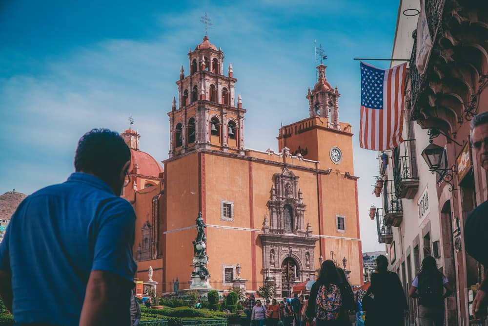 man standing near church