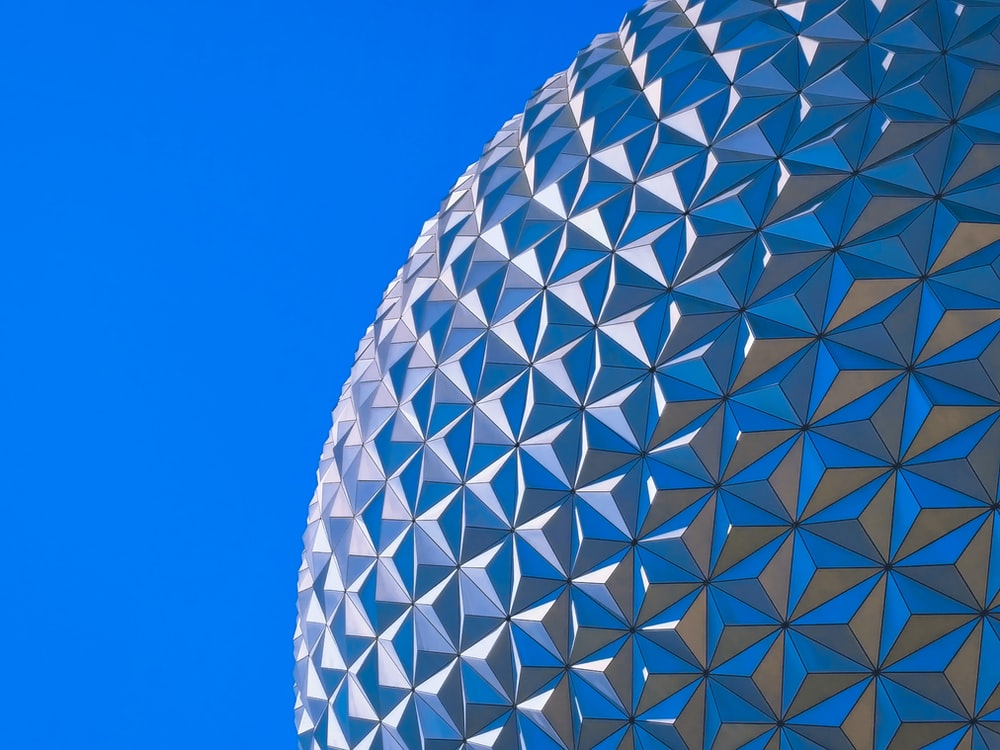 close-up photography of round silver building