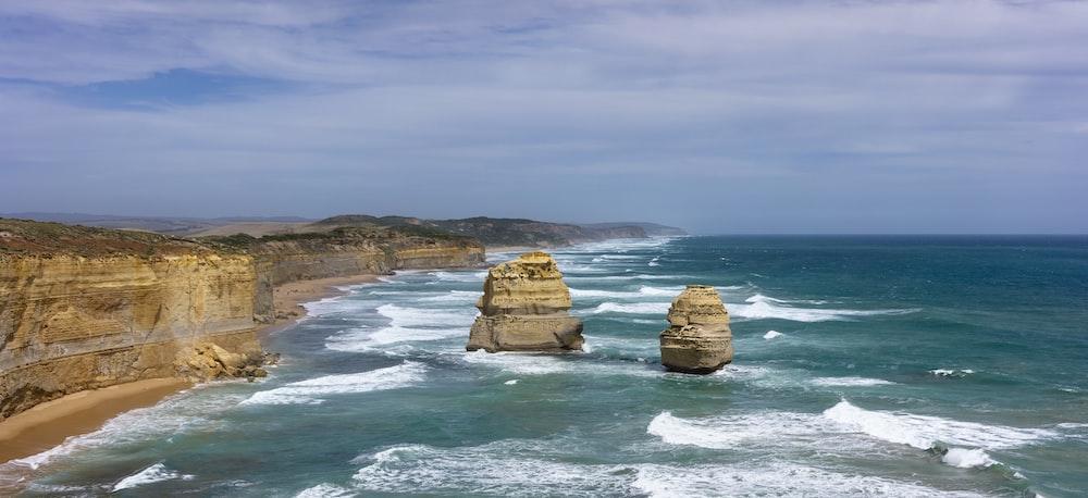 two sea stacks during daytime