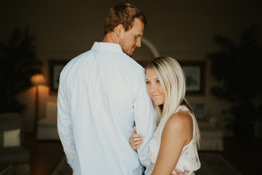 couple inside room on focus photography